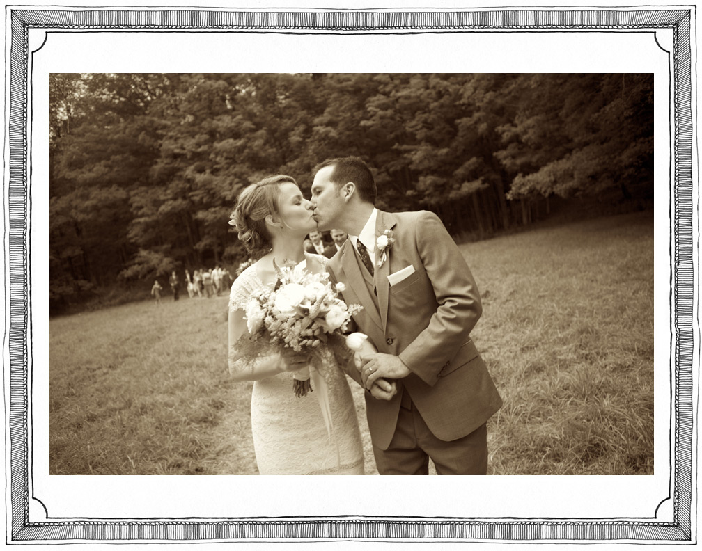 Bride and Groom Kiss in Beautiful Field