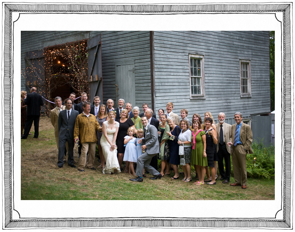 Bride and Groom Pose for Big Family Portrait at Country Wedding