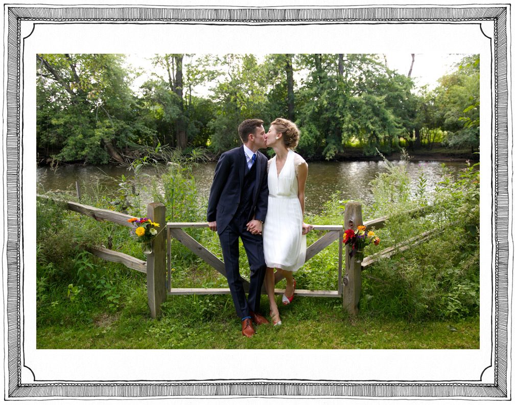 Bride and Groom Kiss at Vintage Summer Wedding